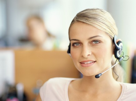 portrait of a businesswoman wearing a headset in an office